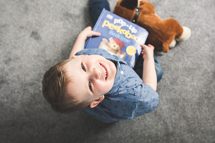 portrait of boy holding storybook